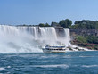 Niagara Falls with tour boat viewed from the river