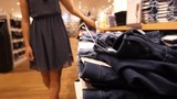 Girl Shopper Choosing New Jeans at Store
