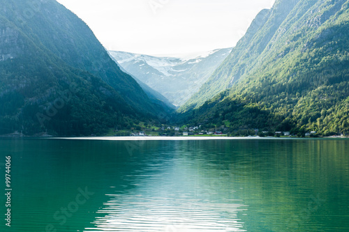 Poster Norwegian fjord with small village surrounded by mountains cover