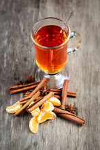 Hot Drink with cinnamon sticks and  tangerine.