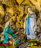 the Blessed Virgin Mary in the grotto at Lourdes - 99771037