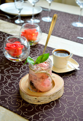 Ice cream with strawberry and a basil