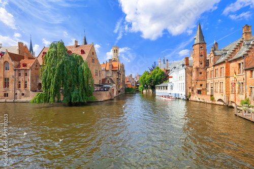 Fotobehang Brugge Dock of the Rosary (Rozenhoedkaai) and Belfry. A scene from a medieval fairytale in Bruges, Belgium