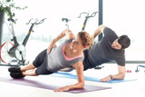 Fototapety Workout at fitness club