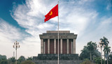 Ho Chi Minh mausoleum in Hanoi with red communistic flag