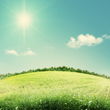Beauty seasonal backgrounds with green hills under blue skies
