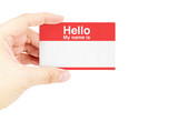 "Hand holding business card with ""Hello My name is"" with white ba"