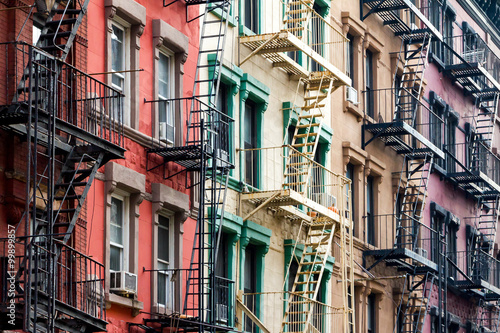 Colored Apartment Buildings in New York City - 99899857