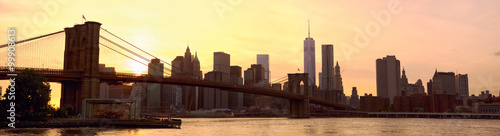 Manhattan skyline panorama with Brooklyn Bridge at sunset, New York, United States