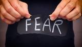 Woman ripping Fear w...