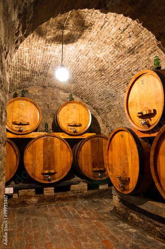 Fototapeta Old traditional dark wine cellar with big wooden barrels