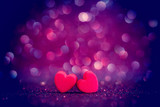 Fototapety red Heart shapes on abstract light glitter background