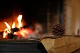 Fototapety Fir cone at the fire place
