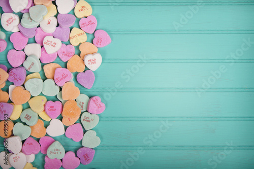 Candy conversation heartson a turquoise blue background