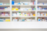 pharmacy counter with blur shelves of drug in the pharmacy drugs