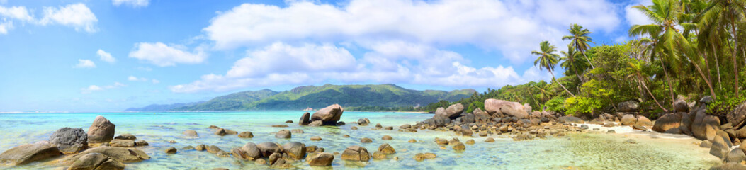 Tropical beach panorama with palms and rocks, Mahe Island, Seychelles