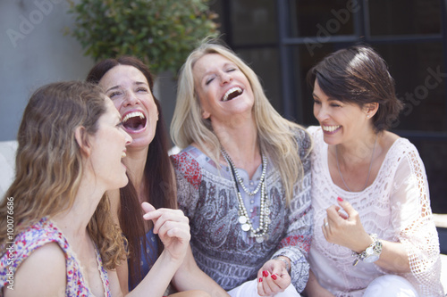 Happy group of adult women having fun