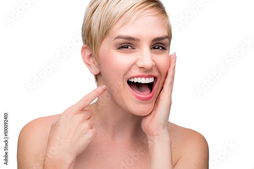 Cute fun laughing female with perfect white teeth straight smile pointing at mouth