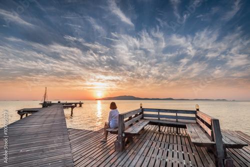 Aluminium Poort Women looking at sunset ,background twilight