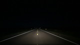 Country Road Driving at Night in Middle Lane. perspective of a vehicle driving at night over the middle lane on country roads using high beam headlights. Swerving back in and out of lane