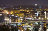 Night view of famous european Prague city - the capital pf Czech republic with reflection in river Vltava and historical bridges