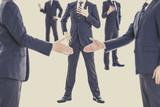 ビジネスマン同士の握手
