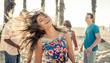 Obrazy na płótnie, fototapety, zdjęcia, fotoobrazy drukowane : Group of friends celebrating on the beach in LA