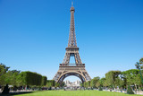 Fototapety Eiffel tower, sunny summer day with blue sky and green Field of Mars