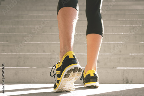 Urban jogger going up the stairs. Poster