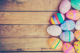 Easter eggs on wooden background with vintage tone. - 100270663