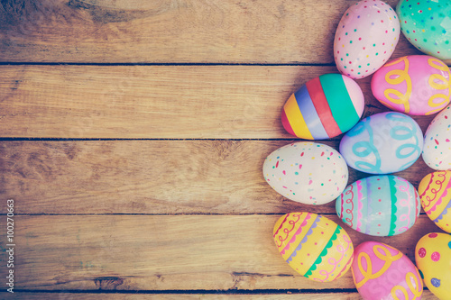 Easter eggs on wooden background with vintage tone.