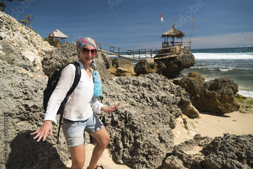 Poster White caucasian girl having fun at the gazebo near ocean