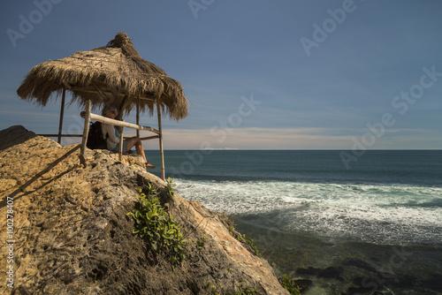 Poster White caucasian girl relaxing in the gazebo near ocean
