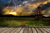 Fototapety Windmill in the thunderstorm.