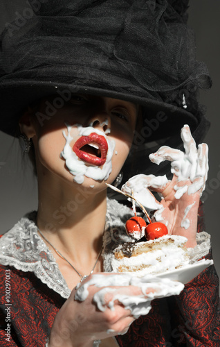 Poster Girl eats greedily cake with cherry