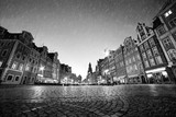 Cobblestone historic old town in rain at night. Wroclaw, Poland. Black and white - 100353809