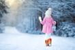 Obrazy na płótnie, fototapety, zdjęcia, fotoobrazy drukowane : Adorable girl with lamp and candle in winter on Xmas eve outdoors