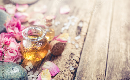 Massage oil, petals flowers and zen stones. © valya82