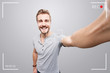 canvas print picture - Handsome man takes a video of himself