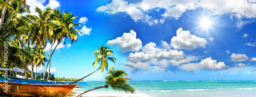 Beach panorama: Perfect tropical paradise beach with turquoise blue water, blue sky, fisherman boat and coco palm :)