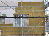 House External Wall Insulation with Fiberglass. Energy Saving Concept.