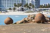 Blue beach umbrellas and sunbeds on Sandy Beach in Ayia Napa, Cy