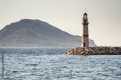 Fototapeta Seascape and the Lighthouse on the Coast