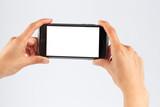 Female hands holding mobile phone horizontally - 100497279