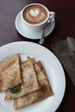 Блины с начинкой и кофе на столе