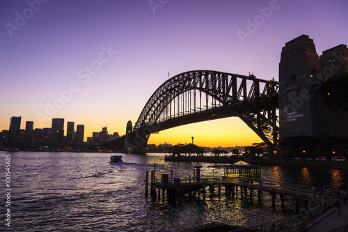 Plagát, Obraz A silhouette of Sydney harbour bridge at sunset.