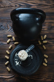 Kettlebell weight, scoop of protein and vitamins, above view