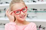 little girl in glasses at optics store - 100548810