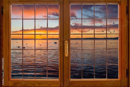 Fototapeta Tramonto sul lago