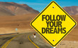 Follow Your Dreams sign on desert road
